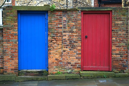 blue door and red door in brick wall