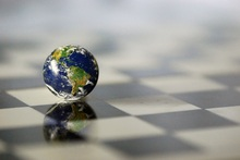globe sitting on chessboard