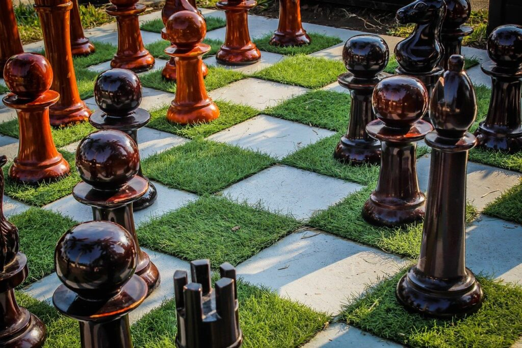 life size chessboard on white and green grass squares